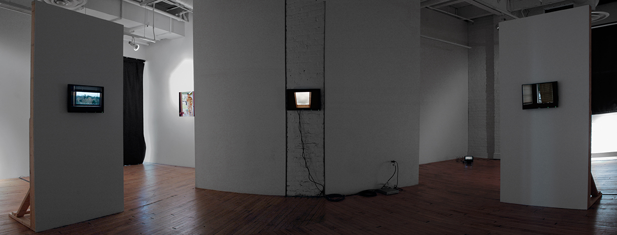 Waiting Room, 2006 (installation view) archival inkjet print, 4 channel HD video loops and constructed walls dimensions variable