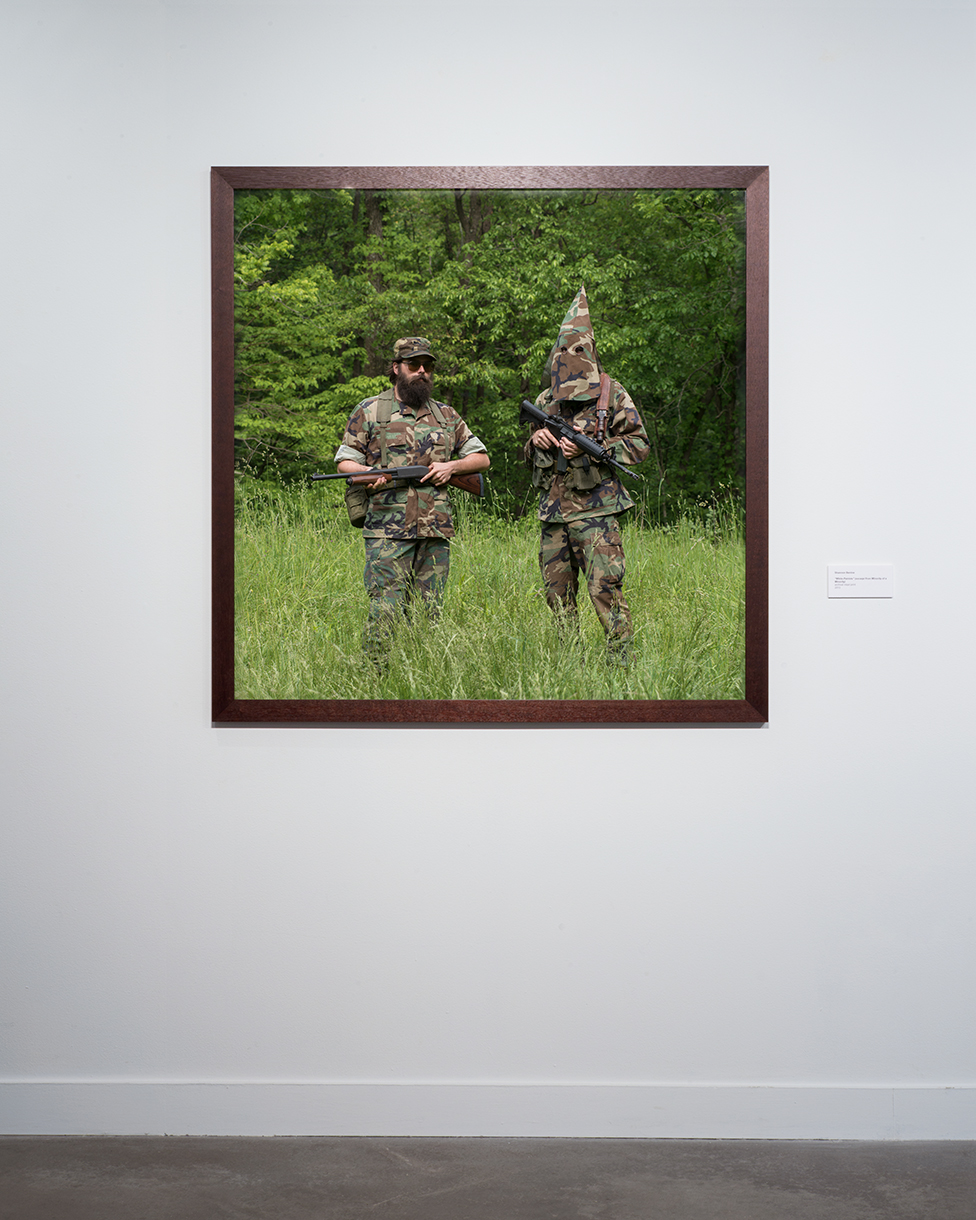 """White Patriots,"" 2013 (installation view) Two veterans reenact an image of two white separatists at a paramilitary compound ca. 1979 40 x 40 inches, archival inkjet print"